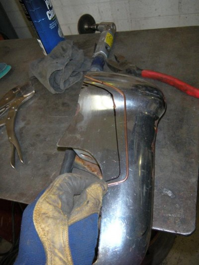Custom bumber how-to showing tig rod to shape and marked