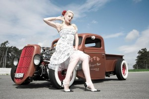 Pinup model Zoe Scarlett with 1932 Ford pickup primer red