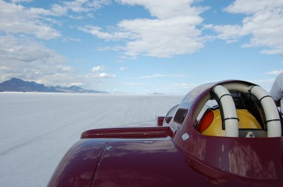 Bonneville roadster speed racing over drivers shoulder