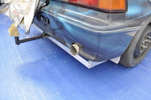 Hondata CRX with a thermal wrapped exhaust and belly tray bracing