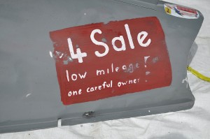 """Low Mileage, careful owner"" for sale sign"
