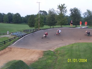 Hot Rod BMX racers cornering hard for the checkered