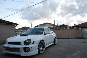 Bugeye Subaru WRX running aggressive fitment HellaFlush wheels