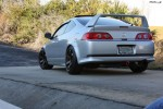 Rear 3/4 quarter view of an aggressive fitment RSX