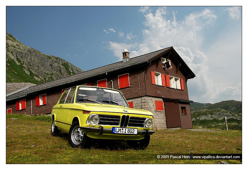 Classic Bimmer and old German farm is a great photo