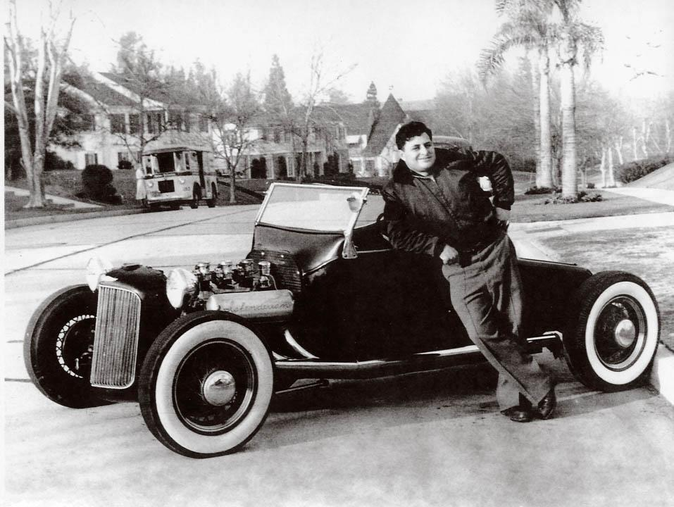 "Ed ""Isky"" Iskendarian poses next to his 1924 T bucket roadster hot rod"