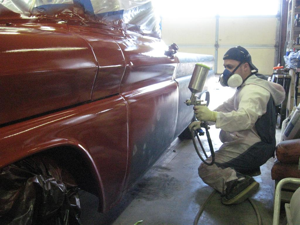 Laying down red oxide base paint on US Forest Service shop truck