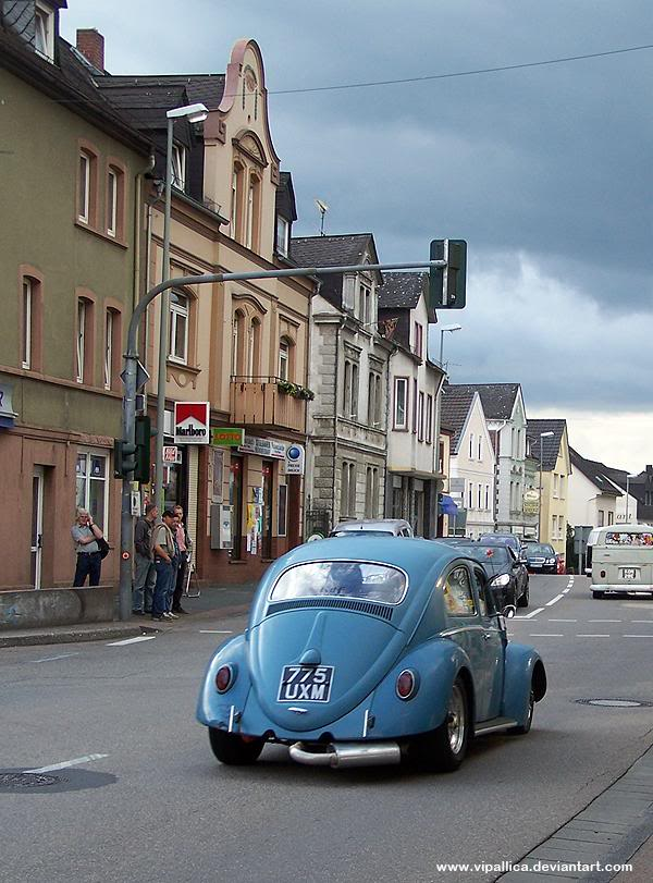 Cal Look Bug cruising down a quaint street in Germany