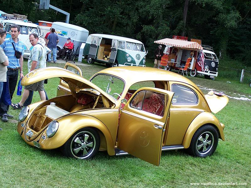 Gold oval window Bug with chrome Porsche Fuch wheels in Germany