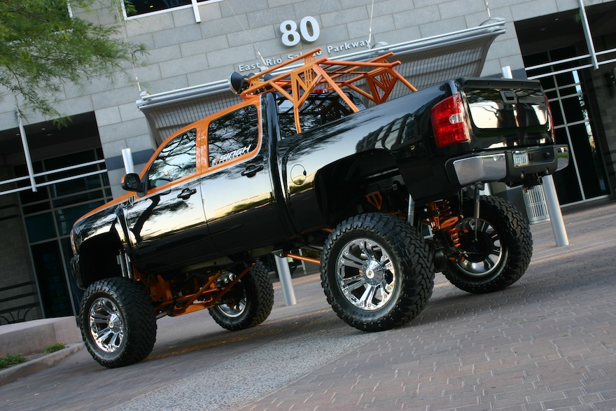 20-inch wheels, lifted truck, black and orange two tone