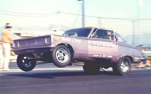 Charlie Allen's open door burnout Dart Funny Car at Irwindale Dragstrip