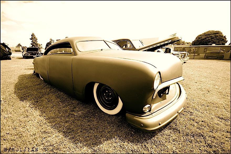 "Smooth flat paint ""primer rod"" kustom cuttin' grass at the Arroyo Car Show"