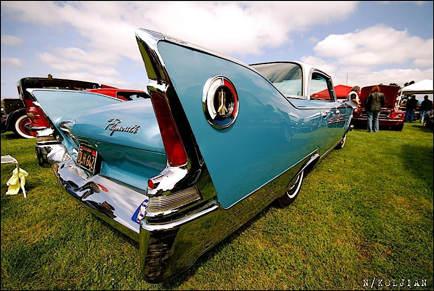 Baby blue winged Plymouth classic.  50's Americana at its finest