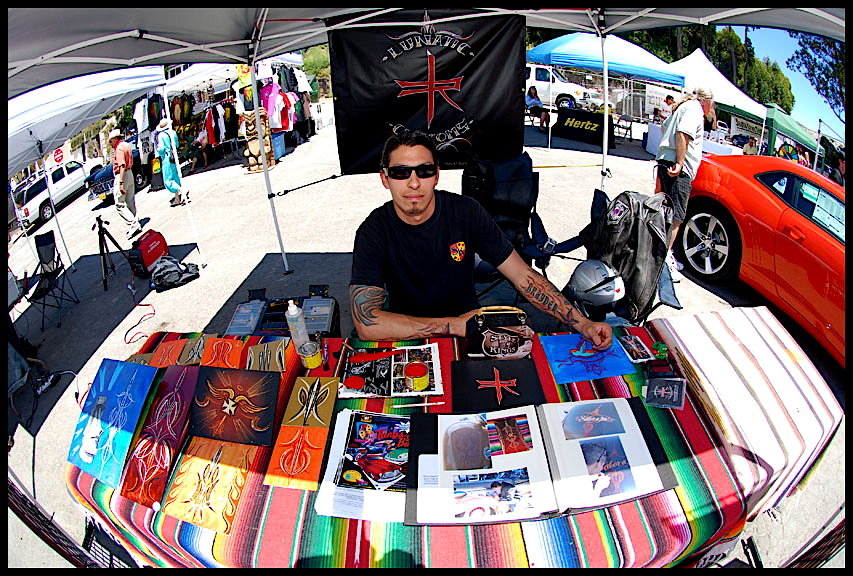 Pinstriping artist at hot rod show