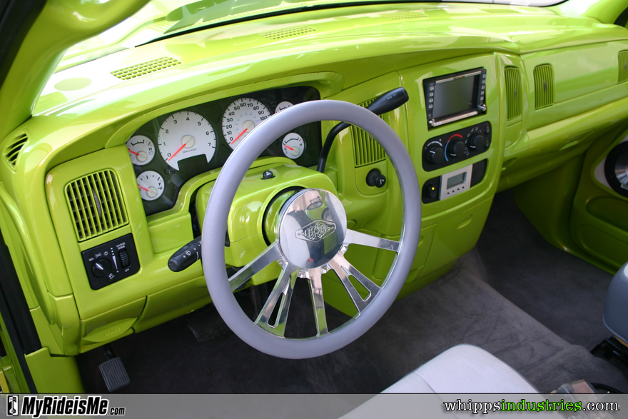 Billet wheel, white gauges, painted dash, double din stereo