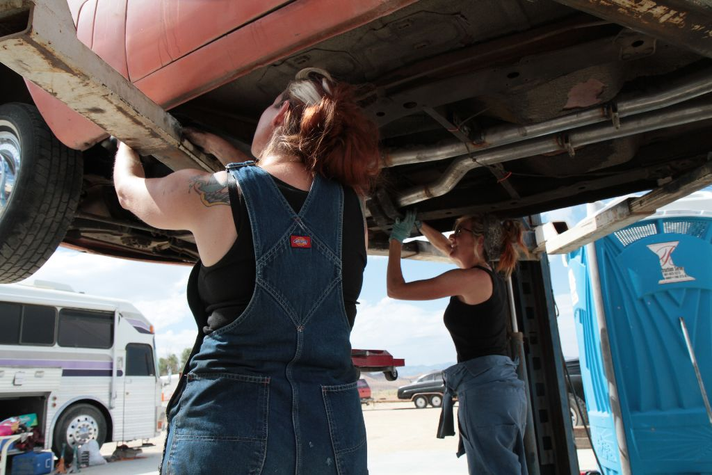 Grease Girl and Lori Hard At Work, girl mechanic, hot rod, studebaker, transmission