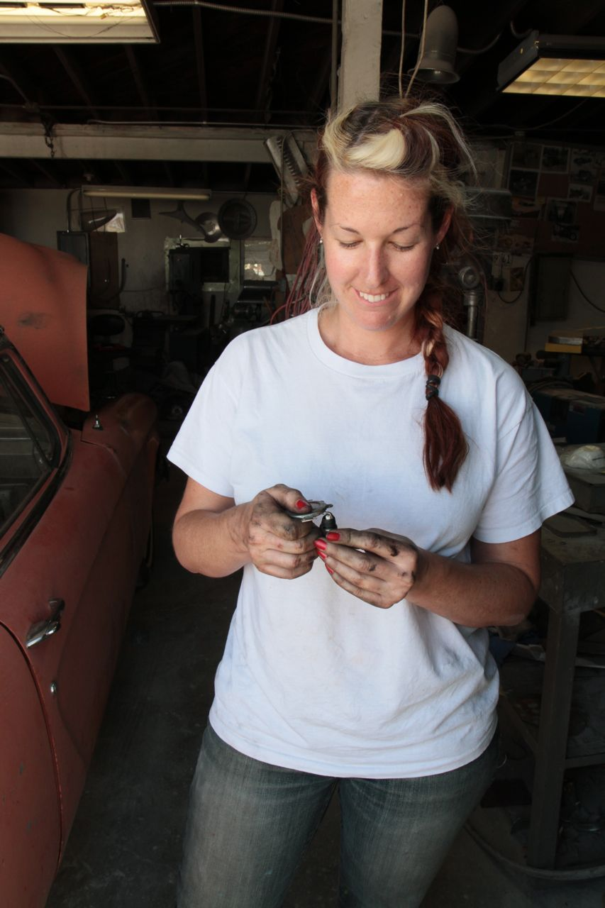 Grease Girl Learning How-To Change Spark Plugs