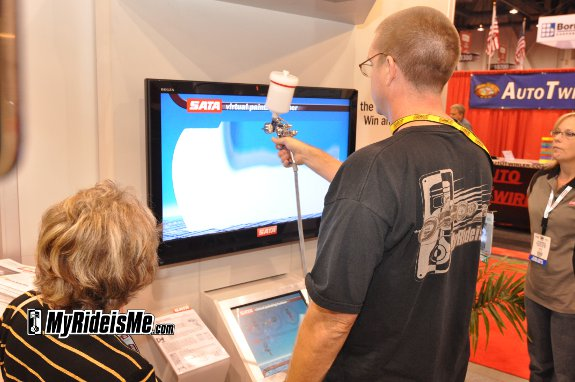 sata spray paint training demo at sema 2010. Black Bedroom Furniture Sets. Home Design Ideas