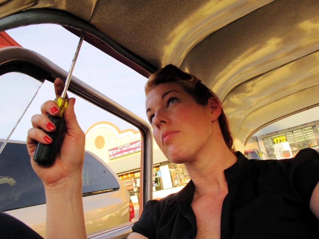 Girl car mechanic works roadside, overheating problems, how-to fix overheating, chevy overheating