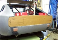 Work began by removing all the tail light parts and panels, and making a cardboard template.
