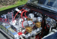 216ci 6 cylinder with rare Rajo racing head, 2 part intake with 3 carbs