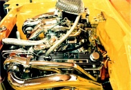 In 1981 I re-painted the engine compartment. In this photo you can see the plexiglas windows in the valve covers.  You can see the gold anodized Crane Roller Rockers thru the windows. I never had any problems with the plexiglas leaking or staying clear.
