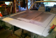 "front 8"" of hood stationary. Hood flips open forward and has a hand fabbed cowl"